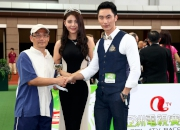 Chen Mengyuan, ATV Miss Asia Pageant 2013 Second Runner-up and Zhong Hao, ATV Mr Asia Contest 2013 winner, present a prize of HK$1,500 and a miniature to the Stables Assistant responsible for Rewarding Hero, the Best Turned Out Horse in the ATV Cup.
