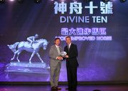 Mr Charles Chan, President of the Hong Kong Racehorse Owners Association, presents the trophy to the owner representative of Most Improved Horse Divine Ten.