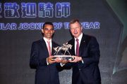 Joao Moreira, voted the Most Popular Jockey of the Year, receives the trophy from Mr Winfried Engelbrecht-Bresges, CEO of The Hong Kong Jockey Club.
