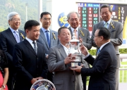 Photo 5, 6, 7:<br> The Hon Martin Liao, Steward of the Club, presents the winning trophy and silver dishes to Owner Mr Pan Sutong, trainer Richard Gibson and jockey Douglas Whyte of Celebration Cup winner Gold-Fun.