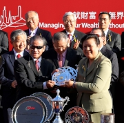 At the trophy presentation ceremony, Club Steward Dr Rita Fan presents the BOCHK Wealth Management Jockey Club Sprint trophy and silver dishes to Huang Kai Wen, owner of race winner Peniaphobia, trainer Tony Cruz and jockey Douglas Whyte.