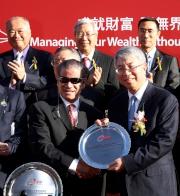 Jason Yeung Chi Wai, Deputy Chief Executive, Bank of China (Hong Kong) Limited, presents a silver dish to winning trainer Tony Cruz.