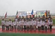 All participating jockeys pose for cameras at the opening ceremony of 2014 World Super Jockeys Series.