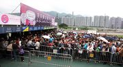 Photos 1, 2: Racing fans receive a collectable souvenir brooch as a free gift upon admission to Sha Tin Racecourse.
