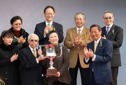 Photo 6, 7, 8: Dr Simon Ip (right), Chairman of the Hong Kong Jockey Club, presents the winning trophy and gold-plated dishes to Dr & Mrs Cornel Li Fook Kwan, owner of Stewards' Cup winning horse Able Friend, and to trainer John Moore as well as jockey Joao Moreira.
