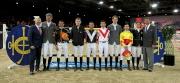 「香港賽馬會130週年 - 騎師馬術混合賽」舉行前,馬會主席葉錫安博士 (右一) 及馬會行政總裁應家柏先生(左一)與各參賽選手合照。