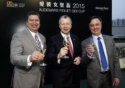 香港賽馬會行政總裁應家柏、賽馬事務執行總監利達賢及評磅及賽事策劃部主管紀禮澤 (右) 祝酒同賀2015年愛彼女皇盃圓滿舉行。