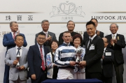 Raymond Lam, the spokesperson of Love Forever collection, presents a miniature to the winning jockey Zac Purton.