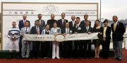Stewards and CEO of the Club, senior management of Lukfook Group and Raymond Lam, the spokesperson of Love Forever collection, pose for the cameras with connections of Packing Pins at the trophy presentation ceremony for the Lukfook Jewellery Cup.