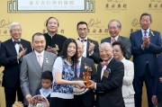 Chairman of the Oriental Watch Holdings Limited Dr Yeung Ming Biu, accompanied by his wife, presents a souvenir to the owner representative of Contentment.