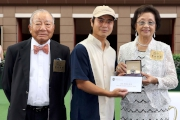 Chairman of the Oriental Watch Holdings Limited Dr Yeung Ming Biu, accompanied by his wife, presents a prize of HK$2,000 and a delicate watch to the Stables representative responsible for Harbour Master (middle), the best turned out horse in the Oriental Watch Sha Tin Trophy.