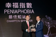 Mr Philip N L Chen, Steward of The Hong Kong Jockey Club, presents the trophy to Huang Kai Wen, owner of Champion Sprinter Peniaphobia.