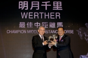 Mr Anthony W K Chow, Deputy Chairman of The Hong Kong Jockey Club, presents the trophy to Mr Johnson Chen, owner of Champion Middle-Distance Horse Werther.