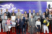 Champion Jockey Joao Moreira together with officiating guests celebrate with champagne splashing.