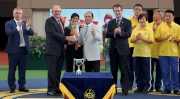Trainer Derek Cruz (right) receives the trophy for this season's Safest and Best Housekeeping Stable Award from Director of Racing Operations and Chairman of the Safety Committee (Racing Operations and Racing Development Board) John Ridley (left)  at Sha Tin racecourse today.