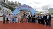 The connections of Deja Vu pose for the cameras at the winning arch after the race.