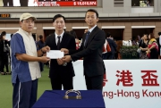 Mr Huang Zhuoqin (right), 2010 Asian Games Silver Medallist in Team Dressage from Guangdong and Mr Shek Wai-hung (middle), 2014 Asian Games Gold Medallist in Gymnastics from Hong Kong present the Best Turned Out Horse award and $1,500 prize to the Stables Assistant  responsible.
