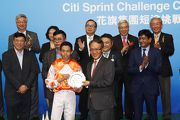 Paulus Mok, Head of Markets & Securities Services, Citi HK, presents a silver dish to Both Lucky��s Jockey Vincent Ho.