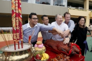 Photo 4, 5, 6<br> Senior Club officials cut the roasted pigs at the bai-sun ceremony.