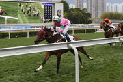 Magic Legend remains unbeaten as he strides away for his second Hong Kong win.