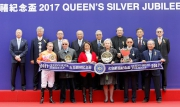 Club Stewards, CEO Winfried Engelbrecht-Bresges (back row, 1st from left) and connections of Helene Paragon take a photo at the Queen's Silver Jubilee Cup presentation ceremony.