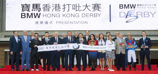 A group photo at the BMW Hong Kong Derby trophy presentation ceremony.