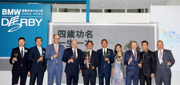 Senior officials of HKJC and BMW toast and congratulate Rapper Dragon's owner Albert Hung Chao Hong (fifth from left) after the horse's victory in the BMW Hong Kong Derby.