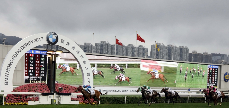 John Moore-trained Rapper Dragon (No. 1), ridden by Joao Moreira, edges Pakistan Star (No. 3) to win the BMW Hong Kong Derby at Sha Tin Racecourse today. Rapper Dragon became the first horse to record a Four-Year-Old Classic Series clean sweep.