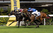 Purton drives Andoyas (far-side) to a neck win over Happy Contender in the Singapore Turf Club Trophy.