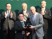Mr David von Gunten, Chief Executive Officer Greater China of Audemars Piguet, presents an Audemars Piguet Royal Oak watch to the winning owner representative for Audemars Piguet QEII Cup winner Neorealism.