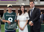 Mr Yves Meylan, Chief Commercial Officer of Audemars Piguet (right) and Ms Michele Reis, Ambassador of the Audemars Piguet QEII Cup 2017 (centre), jointly present a cash prize and a souvenir to the Stables Assistant responsible for Pakistan Star, the Best Turned Out Horse before the Audemars Piguet QEII Cup.