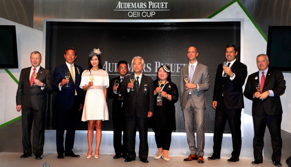 Dr Simon Ip, Chairman of HKJC; Winfried Engelbrecht-Bresges, CEO of HKJC; Anthony Kelly, Executive Director of Racing Business and Operations of HKJC; senior officials from Audemars Piguet, and the owner of Audemars Piguet QEII Cup winner Neorealism, toast for the success of this year's AP QEII Cup.