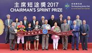 Dr Simon Ip (front row, third from right), Chairman of the Hong Kong Jockey Club, Club Stewards, CEO Winfried Engelbrecht-Bresges (front row, second from right), and the connections of race winner Lucky Bubbles, smile for cameras in the Chairman's Sprint Prize trophy presentation ceremony.