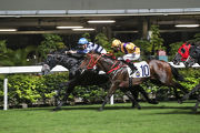 Chad Schofield punches out Ricky Yiu-trained Packing Dragon (inside) to win the Class 2 Cornwall Handicap (1800m).