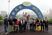 Happy connections of Romantic Touch celebrate their success in the winning circle.