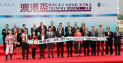 Mr. Anthony Chow, Deputy Chairman of The Hong Kong Jockey Club (front row, fifth from right), Ms Angela Leong, Vice Chairman & Executive Director of Macau Jockey Club (front row, sixth from right), Stewards and senior officials of the HKJC and MJC, guests and the connections of Macau Hong Kong Trophy winner Romantic Touch, smile for the cameras at the Macau Hong Kong Trophy presentation ceremony.