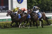 Blazing Speed (orange) wins a three-way battle with Victory Magic (No.6) and Werther (yellow) to take the Standard Chartered Champions & Chater Cup for a second time last year.