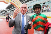 Paul O'Sullivan celebrates his first Hong Kong four-timer with Karis Teetan, the rider of Class 3 Happy Valley Clubhouse Handicap (1650m) winner Willie Way.