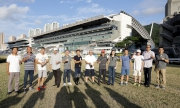 1, 2<br>Club officials and trainers join the champagne toast at Sha Tin Racecourse.