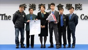 Permanent Secretary for Education Cherry Tse Ling Kit-ching (3rd from left) presents Qualifications Framework certificates to Club employees and trainees who have completed their training under the Cluba��?s Certificate Racing Programme.