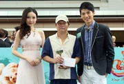 Ms Feng Xue Bing, Miss Asia 2011 and Mr Chiu Shih Chun, Mr Asia 2011, present a prize of HK$1,500 and a miniature to the Stables Assistant responsible for Chater Way, the Best Turned Out Horse trained by David Ferraris in the ATV Cup.