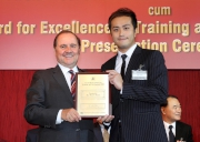 (Right) The Cluba��?s Senior People Development Specialist Takki Chan collects the HKMA Outstanding New Trainer Award 2012.