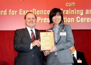 (Right) The Cluba��?s Senior People Development Specialist Gloria Kam collects her HKMA Outstanding New Trainer Award 2012.