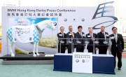Officiating guests unveil the themed horse statue for the BMW Hong Kong Derby event theme.  From left:<br>