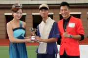 Ms Chen Ian Rung, winner of ATV Miss Asia Pageant 2012 and Mr Zhu Xiaohui, winner of ATV Mr Asia Contest 2012, present a prize of HK$1,500 and a miniature to the Stables Assistant responsible for Majestic Falcon, the Best Turned Out Horse in the ATV Cup.