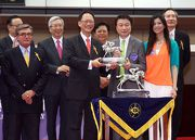 Military Attack is elected the Most Popular Horse of the Year.  Mr Philip N L Chen, Steward of The Hong Kong Jockey Club, presents the trophy to owners Mr & Mrs Steven Lo Kit Sing.