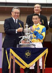 Mr Anthony W K Chow, Steward of The Hong Kong Jockey Club, presents the Willy Kan Memorial Cup to Dicky Lui, Champion Apprentice Jockey of the 2012/13 racing season.