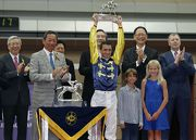 Dr Simon S O Ip, Steward of The Hong Kong Jockey Club, presents the winning trophy to Douglas Whyte, Champion Jockey of the 2012/13 racing season.